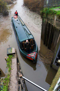 John Revell steers his boat Olive Emily through the lock into the Old Bedford River at the latest attempt made in November.