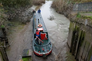 John Revell reverses Olive Emily into and through the Salters Lode sluice gate to join the Old Bedford river.